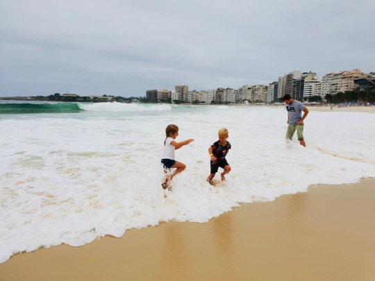 Kids getting caught in a wave