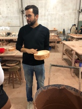 Our guide telling us all about their ceramics (in english)