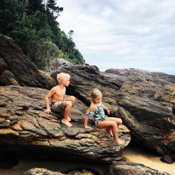 Exploring the rocks framing the beach