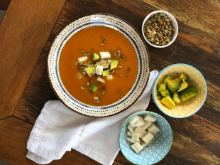 Pumpkin soup with seeds, avocado, cheese